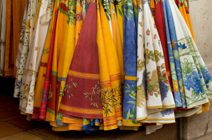 Photo of colorful tablecloths in Provence, France